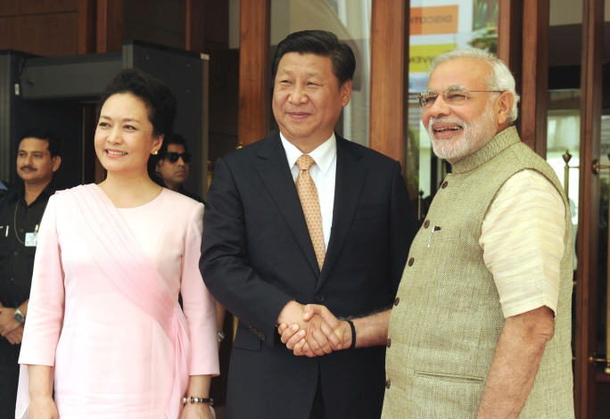 Image by By Narendra Modi via Wikimedia Commons. https://commons.wikimedia.org/wiki/File:PM_and_Chinese_President_Xi_Jinping_witness_signing_of_3_MoUs_in_Ahmedabad_(15275647382).jpg