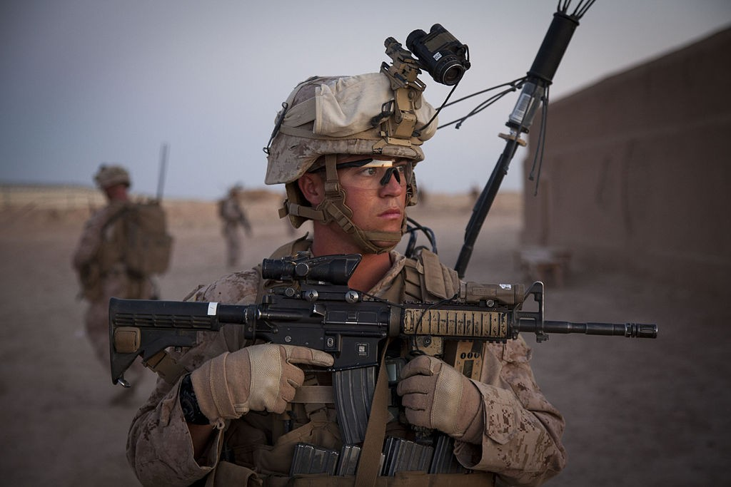 Image by Cpl Kowshon Ye via Wikimedia Commons. https://commons.wikimedia.org/wiki/File:U.S._Marine_Corps_Sgt._Ryan_Burks,_a_squad_leader_with_Fox_Company,_2nd_Battalion,_8th_Marine_Regiment,_Regimental_Combat_Team_7,_provides_security_during_a_mission_rehearsal_at_Camp_Bastion,_Helmand_province_130527-M-QZ858-089.jpg