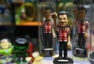 """""""Duterte toys"""" in a fist bump gesture are displayed in a booth at a toys exhibition hall in the Mall of Asia, the country's largest mall chain at suburban Pasay city south of Manila, Philippines Saturday, June 11, 2016. Artist Dennis Mendoza said he made the Duterte toys to honor new President-elect Rodrigo Duterte. The toys sell for P1,000 pesos or $21 dollars each.(AP Photo/Bullit Marquez)"""