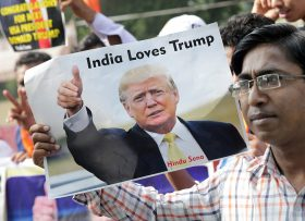 epa05623811 Indian activists from the right-wing organization, Hindu Sena holding posters depicting US Republican presidential candidate Donald Trump celebrate the expected presidential election win in the US elections, in New Delhi, India, 09 November 2016. Americans vote on Election Day to choose the 45th President of the United States of America to serve from 2017 through 2020.  EPA/HARISH TYAGI