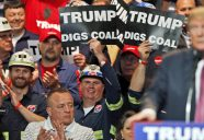 FILE- In this May 5, 2016 photo, Coal miners wave signs as Republican presidential candidate Donald Trump speaks during a rally in Charleston, W.Va. Trump's election could signal the end of many of President Barack Obama's signature environmental initiatives. Trump has said he loathes regulation and wants to use more coal and expand offshore drilling and hydraulic fracturing. (AP Photo/Steve Helber, File)
