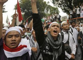 Muslim protesters shout slogans during a rally against Jakarta Governor Basuki Tjahaja Purnama, popularly known as Ahok, in Jakarta, Indonesia, Friday, Nov. 4, 2016. Tens of thousands of hard-line Muslims marched Friday on the center of the Indonesian capital to demand the arrest of the minority-Christian governor for alleged blasphemy. (AP Photo/Achmad Ibrahim)