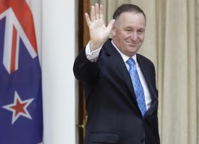 FILE - In this Oct. 26, 2016 file photo, New Zealand's Prime Minister John Key waves to media before his meeting with Indian counterpart Narendra Modi in New Delhi, India. John Key stunned the nation on Monday, Dec. 5 when he announced he was resigning after eight years as leader. (AP Photo/Manish Swarup, File)