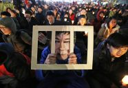 epaselect epa05653390 A South Korean wears Park Geun-hye behind bars-mask while attending a candlelight rally against South Korean President Park Geun-Hye in Seoul, South Korea, 30 November 2016. The protesters gathered to demand South Korean President Park to resign after she had issued a rare public apology in which she acknowledged close ties to Choi Sun-sil, who is in the center of an alleged corruption scandal.  EPA/JEON HEON-KYUN