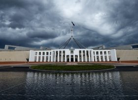 Storm clouds are seen building up over Parliament House in Canberra, Wednesday, Feb. 19, 2014. Canberra has been hit by strong rain and winds. (AAP Image/Lukas Coch) NO ARCHIVING