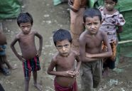 FILE - In this June 24 2014, file photo, Rohingya children gather at the Dar Paing camp for Muslim refugees, north of Sittwe, western Rakhine state, Myanmar. Abdul Razak Ali Artan, the Somali-born student who carried out a car-and-knife attack at Ohio State University on Monday, reported railed on his Facebook account against U.S. interference in countries with Muslim communities. But he specifically protested the killing of Muslims in Myanmar _ also known as Burma _ where the Rohingya ethnic minority faces discrimination and occasional violence from the Buddhist majority and the army and bureaucracy. The Rohingya draw occasional international attention when the violence against them becomes too large to ignore, or when they seek foreign shores as boatpeople in great numbers, but their plight is generally ignored. (AP Photo/ Gemunu Amarasinghe, File)