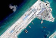"(FILES) This file handout photo taken on April 2, 2015 by satellite imagery provider DigitalGlobe and released to AFP by the Asia Maritime Transparency Initiative department at the Center for Strategic and International Studies (CSSI) think tank shows a satellite image of what is claimed to be an under-construction airstrip at Fiery Cross Reef in the Spratly Islands in the disputed South China Sea.  Japan on July 21, 2015 slammed Beijing's bid to reclaim land in the South China Sea as a ""coercive attempt"" to force sweeping maritime claims, in a defence paper that comes as Tokyo is expanding the role of its own military.      AFP PHOTO / MANDATORY CREDIT: CSIS Asia Maritime Transparency Initiative / DigitalGlobe -----EDITORS NOTE---- RESTRICTED TO EDITORIAL USE -- MANDATORY CREDIT -- ""AFP PHOTO / CSIS Asia Maritime Transparency Initiative / DigitalGlobe"" - NO MARKETING - NO ADVERTISING CAMPAIGNS - DISTRIBUTED AS A SERVICE TO CLIENTS - NO ARCHIVES"