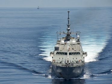 150511-N-VO234-286 SOUTH CHINA SEA (May 11, 2015) The littoral combat ship USS Fort Worth (LCS 3) conducts patrols in international waters of the South China Sea near the Spratly Islands as the People's Liberation Army-Navy [PLA(N)] guided-missile frigate Yancheng (FFG 546) transits close behind. (U.S. Navy photo by Mass Communication Specialist 2nd Class Conor Minto/Released)