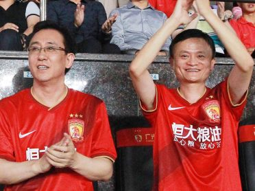 "--FILE--Xu Jiayin (Hui Ka Yan), left, Chairman of Evergrande Group, and Jack Ma Yun, Chairman of Alibaba Group, watch the second quarter-final match between China's Guangzhou Evergrande and Australia's Western Sydney Wanderers of the 2014 AFC Champions League in Guangzhou city, south China's Guangdong province, 27 August 2014.  Evergrande Taobao, the soccer team co-owned by Alibaba Group Holding Ltd and property firm Evergrande Real Estate Group Ltd, could become the first club listed in Asia after it filed for an initial public offering in China. The team, which recently signed Brazilian World Cup winning coach Luiz Felipe Scolari, filed with the National Equities Exchange and Quotations (NEEQ) to list on the so-called ""New Third Board,"" Evergrande said in a filing to the Hong Kong stock exchange on Thursday. The company gave no size for the planned listing, which is pending approval by the NEEQ that operates China's leading over-the-counter (OTC) equity exchange. Chinese e-commerce giant Alibaba last year agreed to pay $192 million for half of the team, just months ahead of the company's record-breaking IPO in the United States. The deal was hatched over a few drinks between co-founder and Executive Chairman Jack Ma and Evergrande's billionaire Chairman Xu Jiayin."