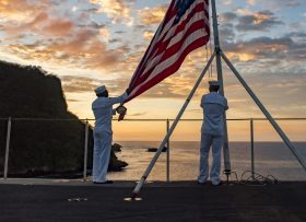 GUAM (Feb. 11, 2017) Aviation Boatswain's Mate (Equipment) Seaman Stephen Mugo and Logistics Specialist 3rd Class Jeremy Boling perform evening colors aboard the aircraft carrier USS Carl Vinson (CVN 70). The ship's carrier strike group is on a western Pacific deployment as part of the U.S. Pacific Fleet-led initiative to extend the command and control functions of U.S. 3rd Fleet. (U.S. Navy photo by Mass Communication Specialist 2nd Class Sean M. Castellano/Released)170211-N-BL637-021  Join the conversation: http://www.navy.mil/viewGallery.asp http://www.facebook.com/USNavy http://www.twitter.com/USNavy http://navylive.dodlive.mil http://pinterest.com https://plus.google.com