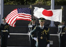 Japan Self-Defense Forces' honor guard members hold flags of the U.S. and Japan after U.S. Defense Secretary Jim Mattis and his Japanese counterpart Tomomi Inada inspected an honor guard at Defense Ministry in Tokyo, Saturday, Feb. 4, 2017. (AP Photo/Eugene Hoshiko)