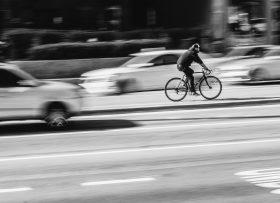Cyclist in a blur of traffic