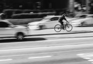 Cyclist in a blur of traffic