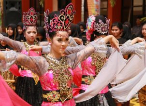 Woman dancing in pink traditional clothing