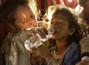 Young girl drinking from water bottle