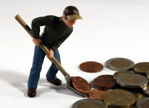 Toy man shovelling coins