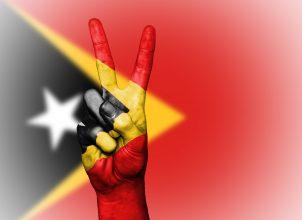 Peace hand sign on Timor-Leste flag