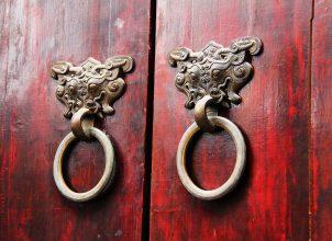 Traditional door handles on red wooden door