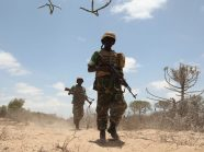 Soldiers belonging to the Burundian contingent of the African Union Mission in Somalia march on the Al Shabab held town of Ragaele in the Hiraan region of Somalia on September 30.